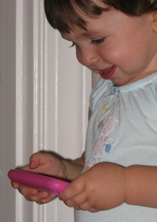 A toddler with an iPhone